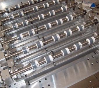 mcservice-modena-progettazione-meccanica-consulenza-tecnica-divisione-macchina-produzione-RFiD-portali-automatica